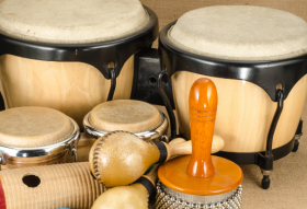 Photograph image of a group of musical percussion instruments on a table
