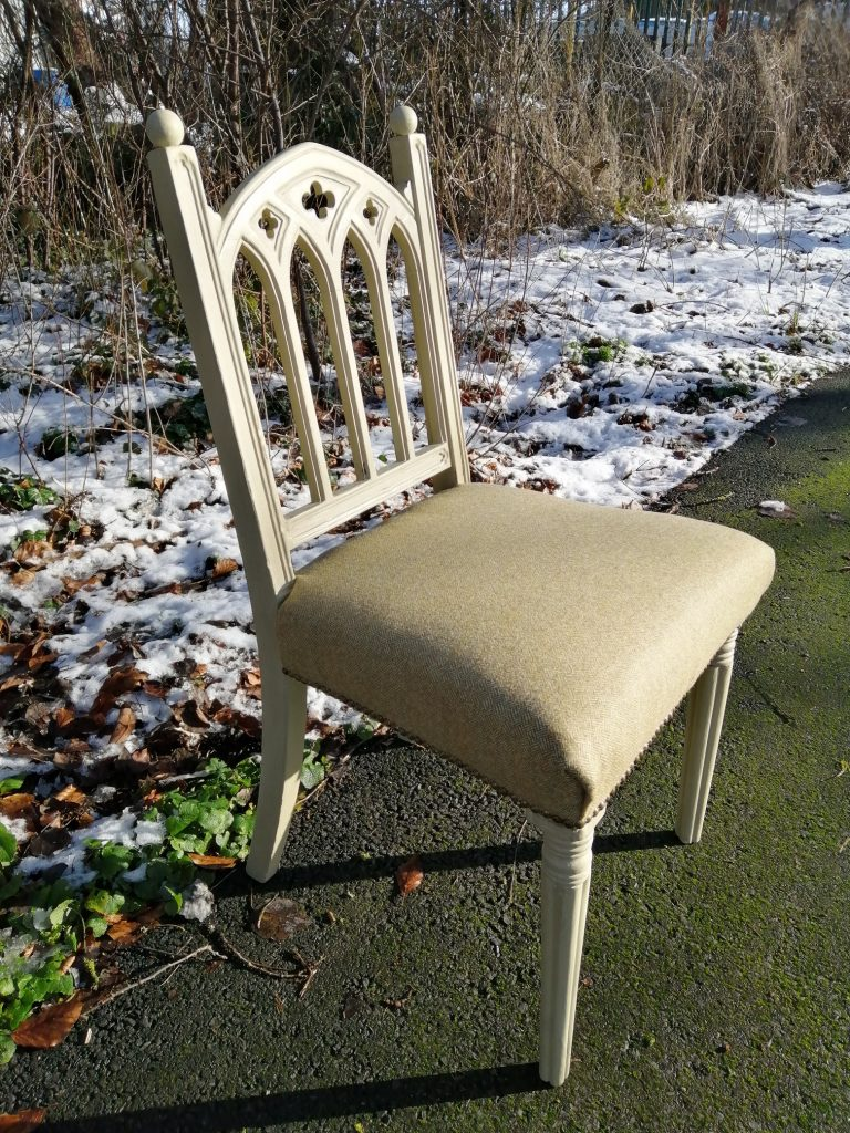 individual upcycled chair with padded seat. Light gold coloured paint and fabric used.