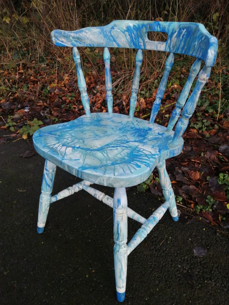 painted chair with unusual blue paint effect over white underlay