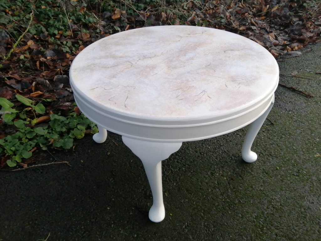 painted round table with three legs